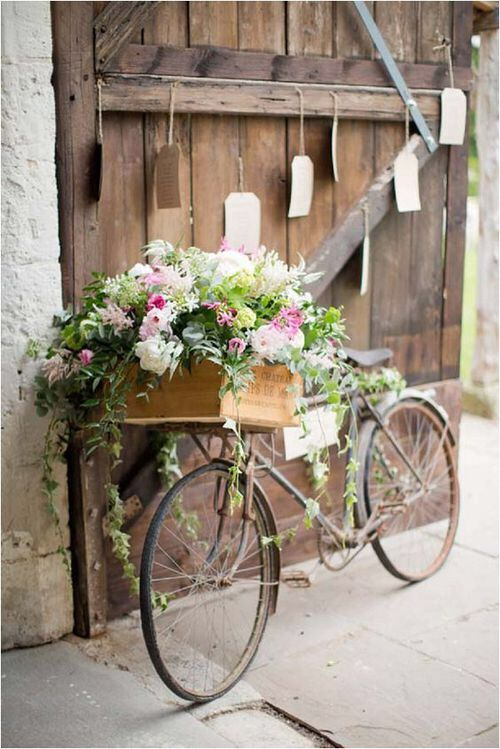 Isn't this a darling rustic vintage bicycle decorated with a giant box of flowers? This would be a beautiful statement wedding decor idea or maybe a beautiful piece of garden art for a French garden.