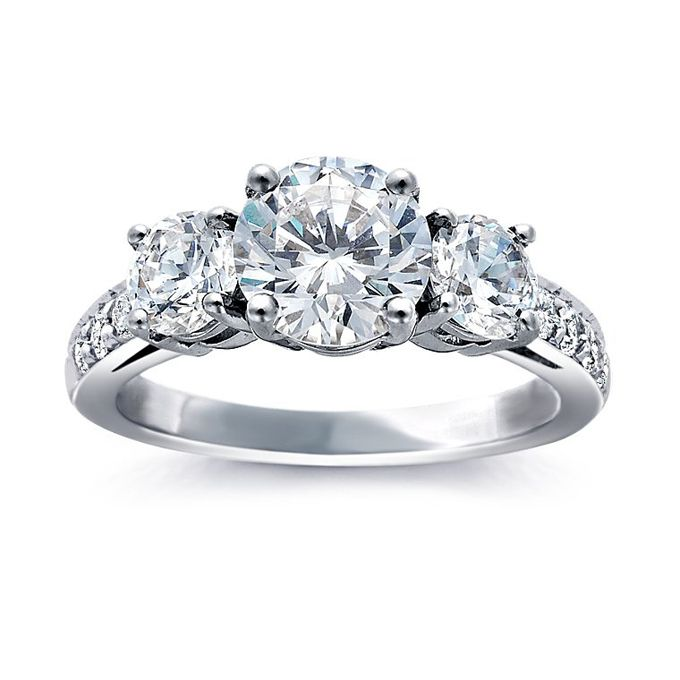 Brides.com: Three-Stone Engagement Rings. Style 5923, three-stone pavé diamond ring in platinum, $1,380 (stones not included), Blue Nile                                                                                                               See more Blue Nile engagement rings.