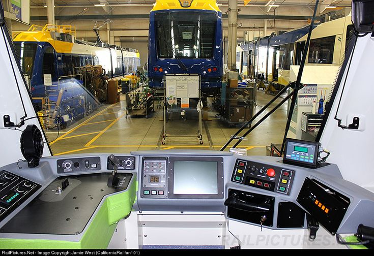 A rare look from inside the operator's cab of a brand new Light Rail Vehicle at the Siemens Manufacturing Plant in Sacramento, CA. This and the cars seen outside the window are going to the Twin Cities Metro Transit System, a light rail division of the Minnesota Northstar Commuter Line. Photo taken with permission as part of a tour of the plant with the Pacific Coast Chapter of the Railway & Locomotive Historical Society.