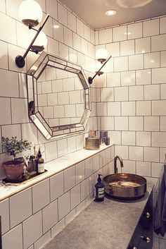 The Way We Play Magazine - Dusty Deco founder Edin Memic Kjellvertz - Bathroom with white tile, vintage mirror and brass sink by superfront