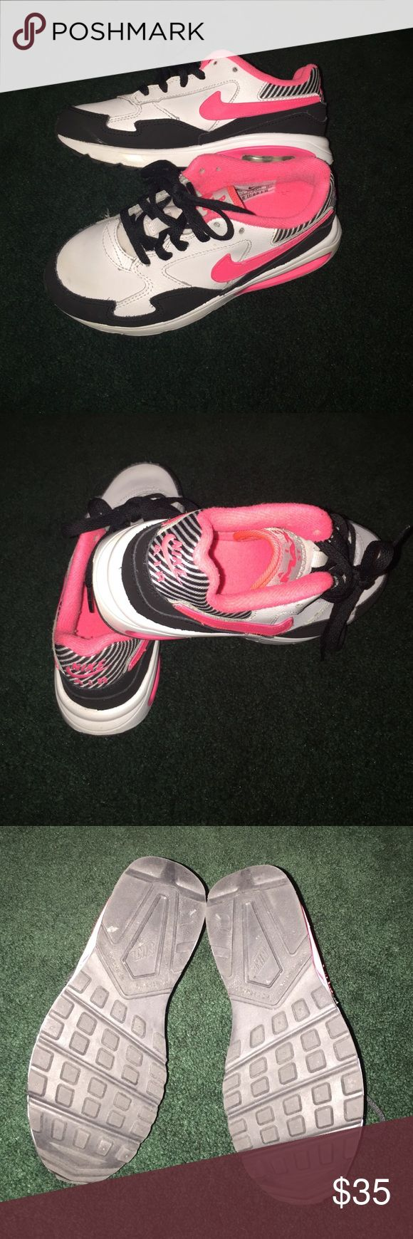 Kids Air Max!!!!! Neon pink and black air max for children!!!! Black cloth material at the front of shoes, white base and a pink swoosh! Shoes are like new!!! Worn a couple times!!! Nike Shoes Sneakers