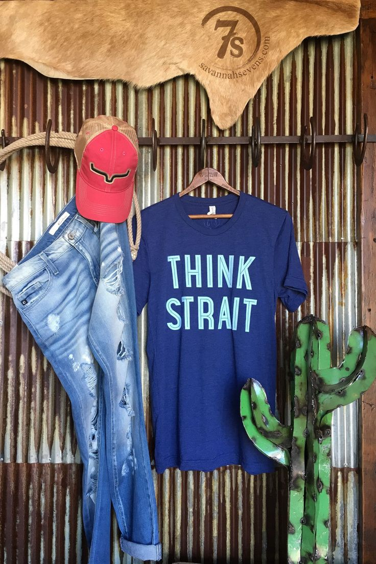 "- ""Think Strait"" George Strait graphic tee - Tri-blend navy with light blue graphics - That perfect weekend comfy tee - Adult unisex size t-shirt - Fits true to size - Shown paired with the Kimes Ranc"