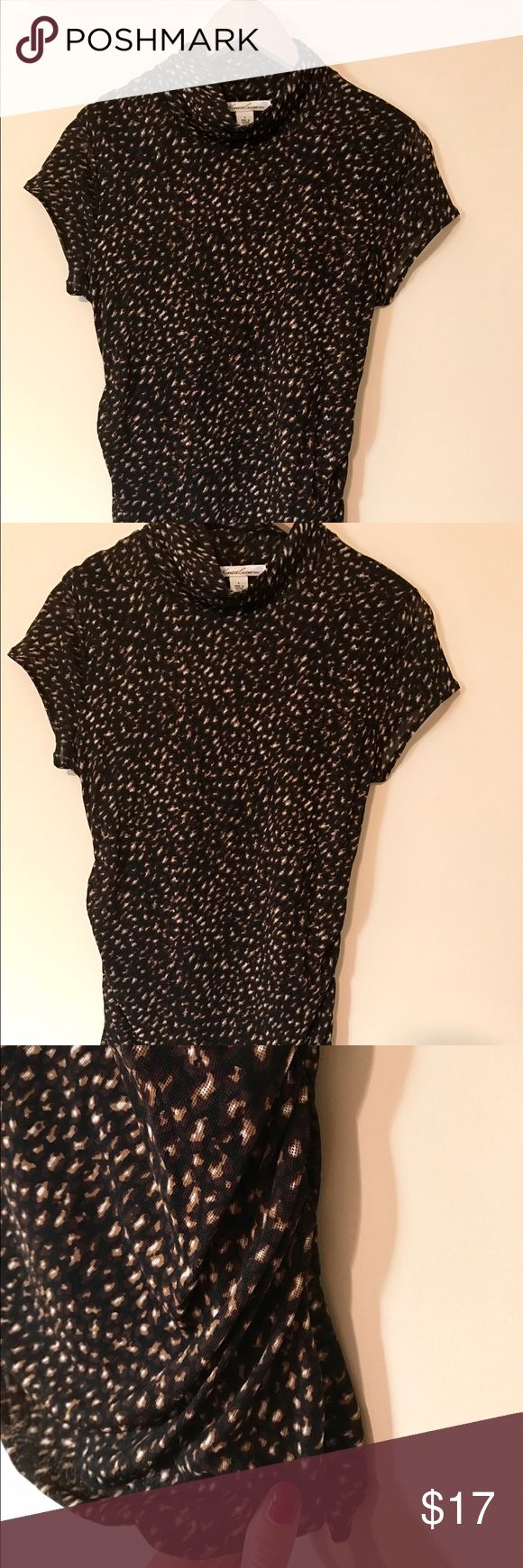 Kenneth Cole Animal Print Top Eye catching animal print top, with cowl neck, short sleeves, and rouching on sides. Flattering and can be worn different seasons. EUC. 100% nylon. Kenneth Cole Tops