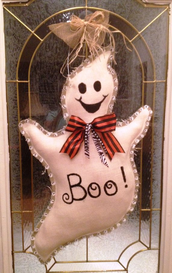 You could make this very easily.  The description says burlap but...it doesn't look like burlap (maybe muslin) to me.  --Painted Burlap Ghost Door Hanger by PinkTulipOfDaphne on Etsy, $55.00