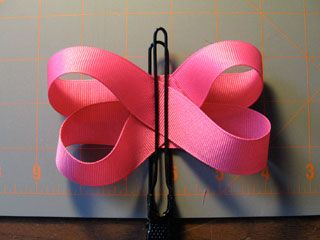 This link describes the same method I use to make most of my boutique-style bows...makes it nice and loopy.