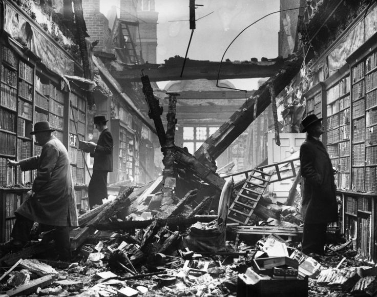 Undeterred by recent bombings, London residents visit whats left of a library during World War II.