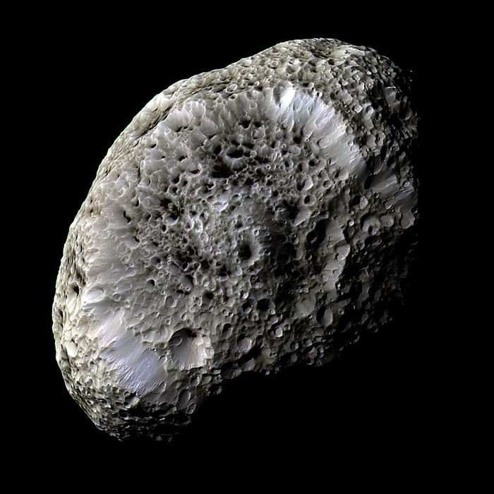 Saturn's sponge-like moon Hyperion. Hyperion is shaped a bit like a potato and, with dimensions of 410 x 260 x 220 km, is one of the largest bodies in the Solar System known to be so irregular. Its odd, almost 'bubbly' appearance, can be attributed to it having a very low density for its size. Because of these properties the entire moon is porous, like a sponge, with well-preserved craters of all shapes and sizes packed together across its surface. Scientists think that this moon is mostly…