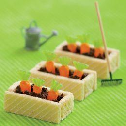 Wafers, chocolate icing, orange Mike n Ikes, green gummies, chocolate cookie crumbs - cute!
