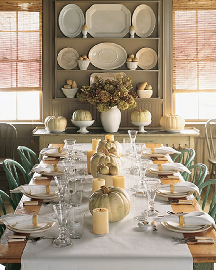 White Pumpkin Centerpiece | Martha Stewart Living - Big, round 'Lumina' pumpkins bring a ghostly glow to a dining room. Place them directly on the table or on serving stands and platters during your Halloween parties.