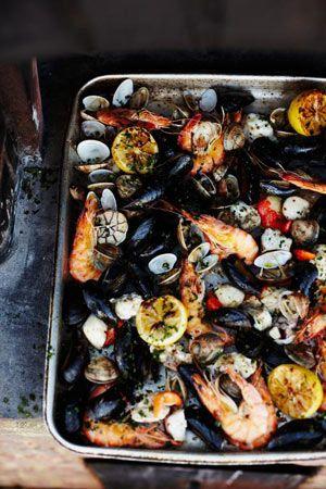 Wood-fired shellfish with gorgeous lemony garlic dressing - Jamie Oliver