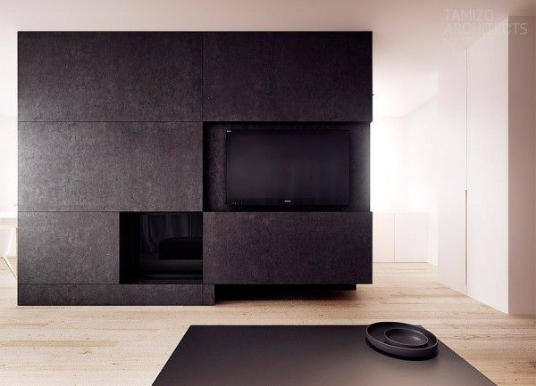 In fact, black is quite deemphasized in this particular house, forming really only the central kitchen appliance island-cum-entertainment-center and poking through in the dark gray living room in the form of a coffee table. This scheme makes sense for a family home that wants to feel spacious and warm.