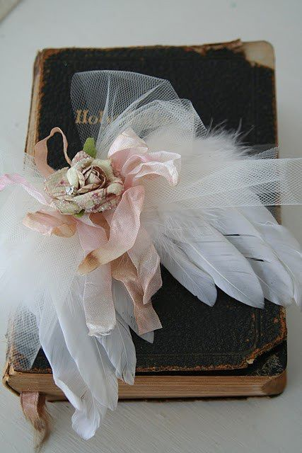 Angel wing corsage atop an old Bible... how clever and inspiring. Uploaded by Pinterest user Belle West