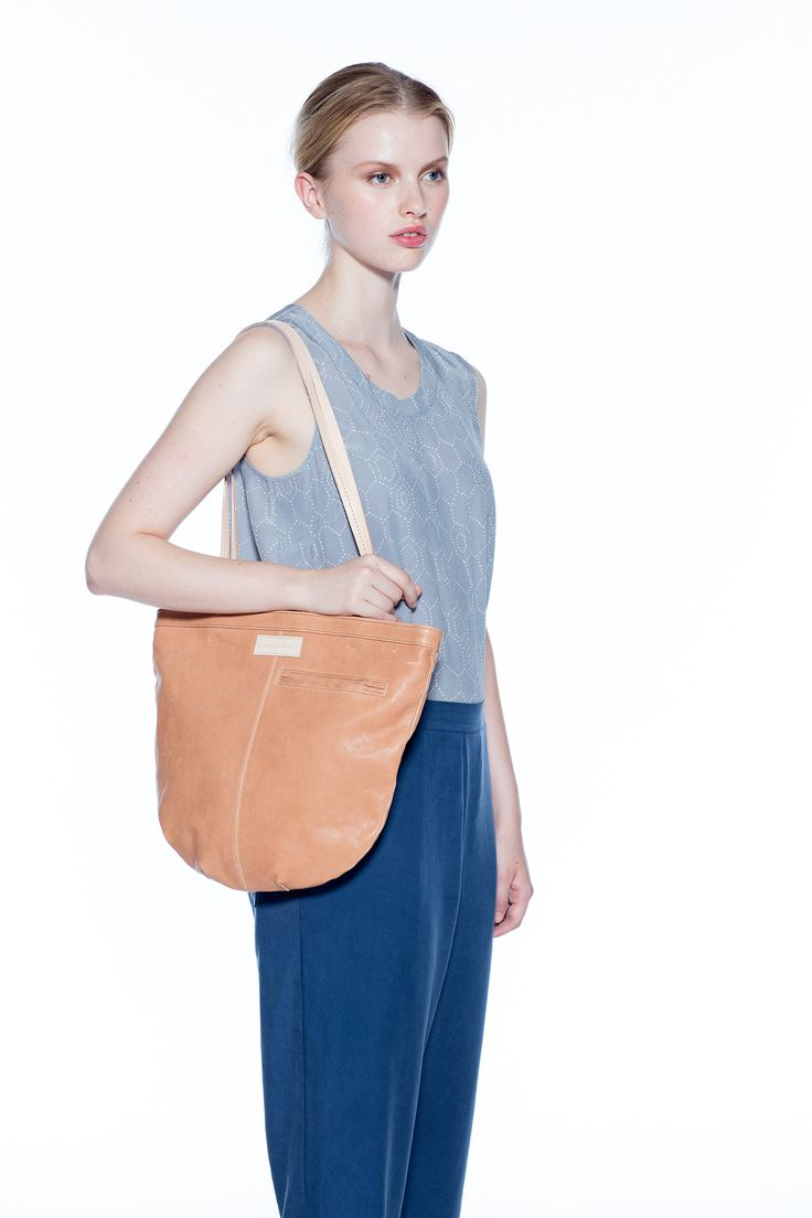 Inspired by a woven basket bag, the Hopper is a functional dream. The outer pocket includes a card pouch with clip on leather cord, handy for swiping...