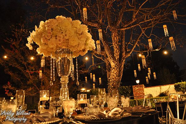 Loveeeee. Hanging crystals and large glass vases. | vibrantbride.com
