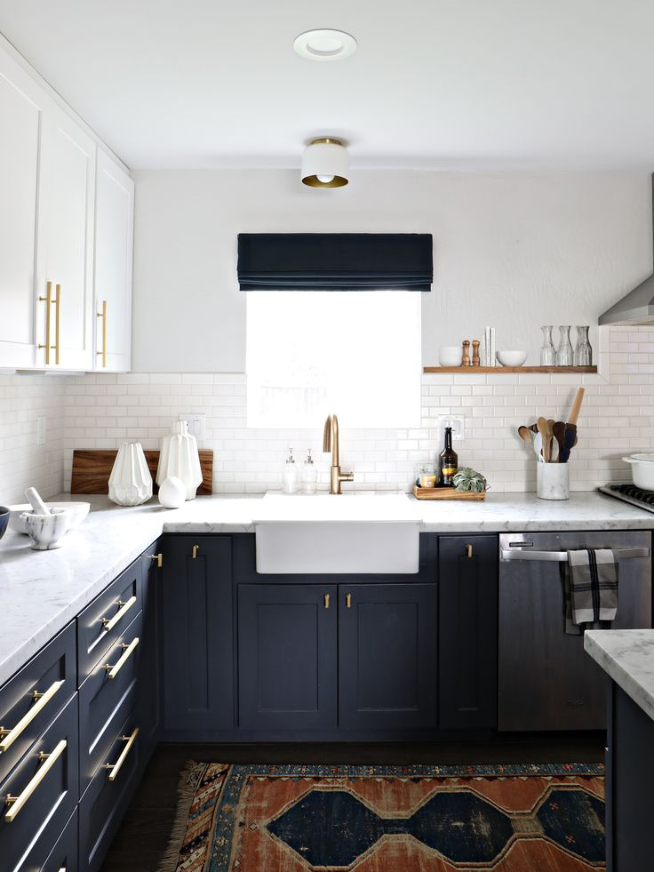 This kitchen is absolutely gorgeous. We adore the subtle, gold toned hardware touches to offset the cool color scheme. Nice insights on the renovation, too!