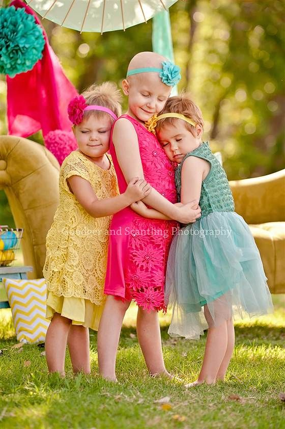 Three little girls retake viral photo to celebrate remission from cancer