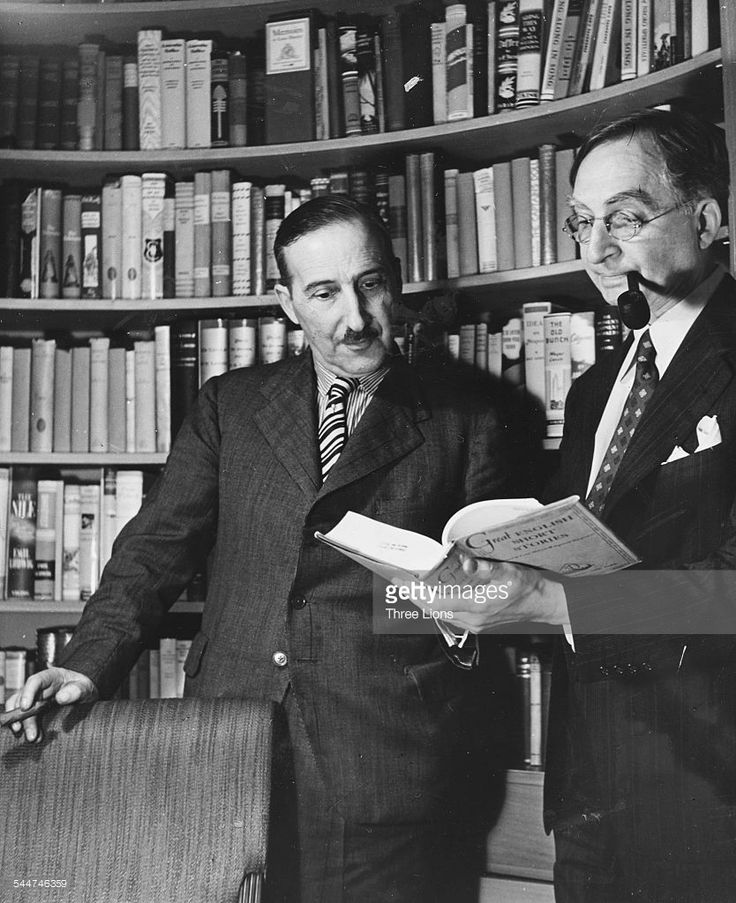 Austrian novelist Stefan Zweig in conversation with his publisher W Huebsch of the Viking Publishing Company, circa 1930.