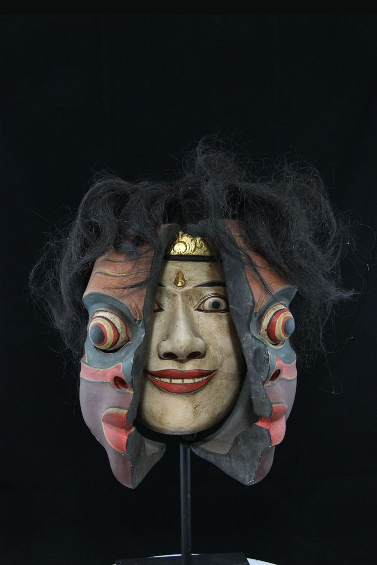 Here is a rarity. Balinese traditional dance masks assuming the form of a Native American transformation mask. What you first see is a Barong demon who opens up revealing the spirit of Dalem. This is the work of a professional Balinese carver who was experimenting with something different back in the late 20th century when they were first hired to reproduce NWC masks for export to the US and Canada. Note the careful antiquing. Balinese professional carver.