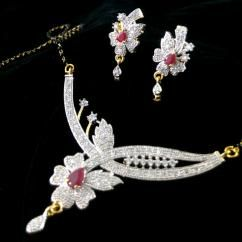 Flower Designer American Diamond Ruby Gold Plated Pendant Earring Mangalsutra Set With Chain *Beautifully hand crafted Pendant and Earrings *Sparkles like real diamond gold Mangalsutra necklace *High quality American Diamonds are used *Can be used in daily routine *Gold plated Mangalsutra pendant set ₹399.00 INR  http://crazyberry.in/online-shopping/artificial-imitation-fashion-jewellery/flower-designer-american-diamond-ruby-gold-plated-pendant-earring-mangalsutra-set-chain