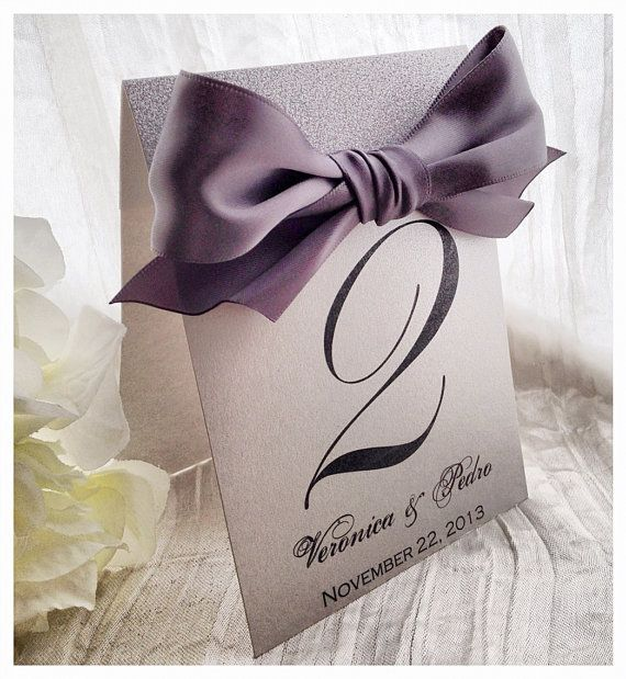 Silver shimmer glitter table number with ribbon  great for weddings, sweet sixteens, birthdays, engagements parties, and other events.