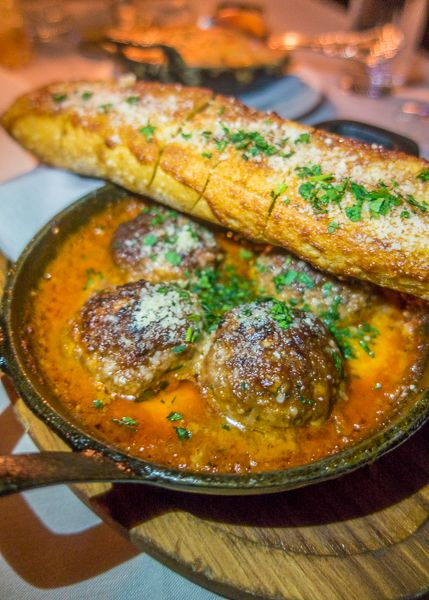 Prime Beef Meatballs with cheese curds and garlic bread at Maple & Ash in Chicago