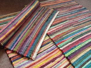 Weaving T-shirt fabric in long strips can make a super cute rag rug without the shaggy look!