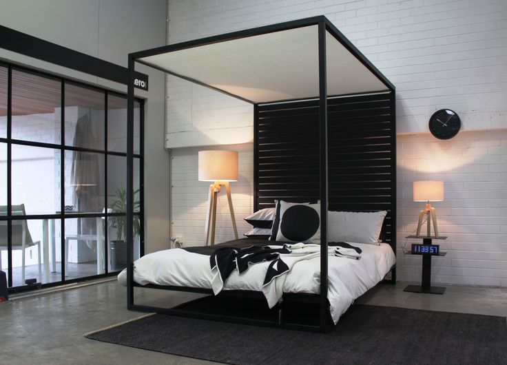 The Four poster bed in textured black powder coat. A modern take on a a  classic