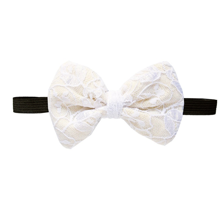 Buttercream Lace Ready tie bow tie - white lace and buttercream backing. $30,00, via Etsy.
