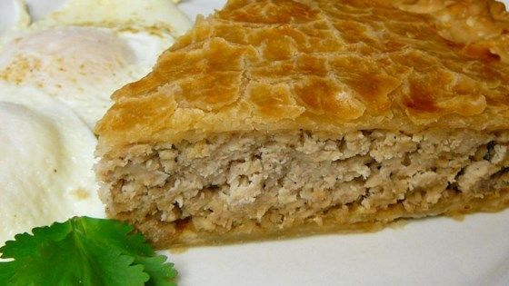 Cinnamon, cloves and allspice are sprinkled over ground pork, mashed potato and onion and simmered in water for about an hour until the flavors are mingled and a thick sauce is created. This tasty filling is spooned into a deep dish pie crust, topped with another crust, and baked until deliciously brown.
