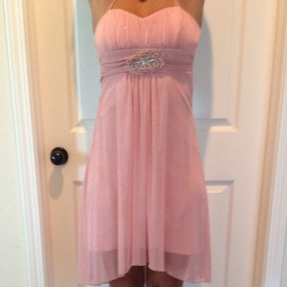 Elegant light pink dress A light pink dress.  Has a light pink slip built in then a light sheer pink and silver sparkles over. It is empires waist with a beautiful sliver design. Has spaghetti straps and built in bra Macy's Dresses