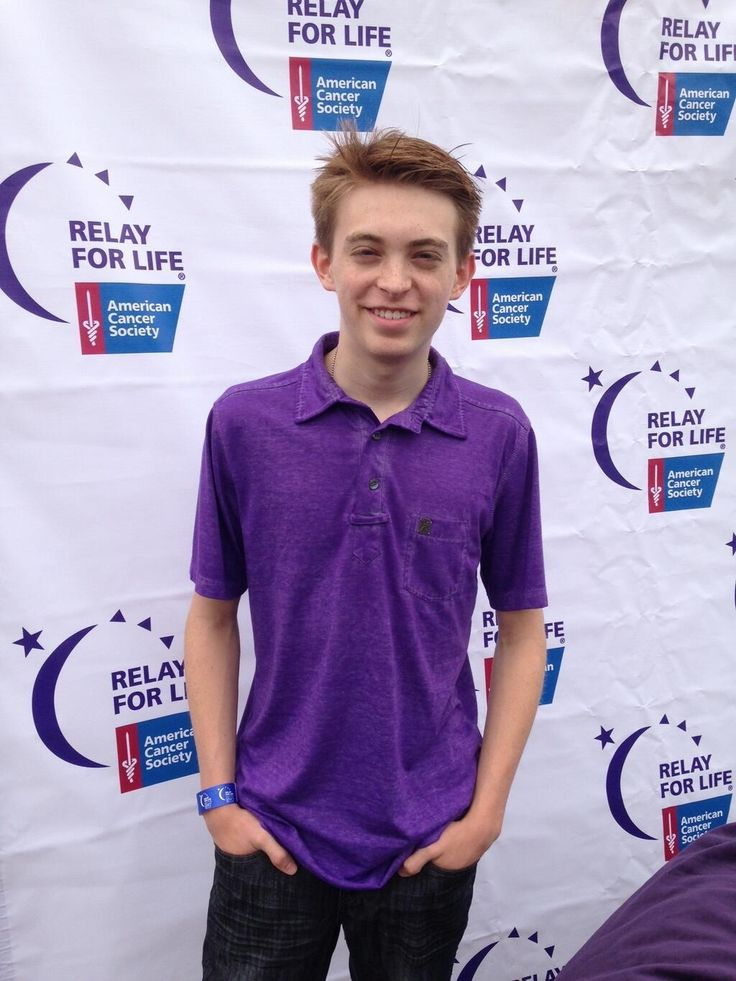 "Relay for life background as a ""red carpet"" style entrance. Have ""photographer"" snapping pics"