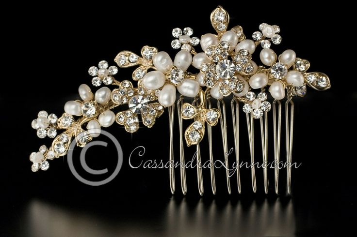 This bridal hair comb is designed with two rhinestone clovers that are complimented by ivory freshwater pearl flowers, rhinestone leaves, an...