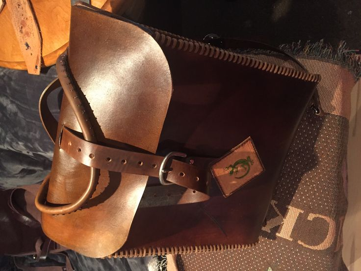 Large volume leather backpack.