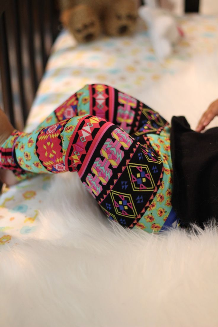 Cute Aztec inspired baby girl leggings for fall, pink, red, green and blue colors. A twist to rainbow baby leggings! This tribal print combines all of the colors of the rainbow into cute and adorable baby girl leggings. So step out of the usual and create a new fashion outfit for your daughter with the help of Made by Jeniffer! Toddler Leggings and Pants collection for children.