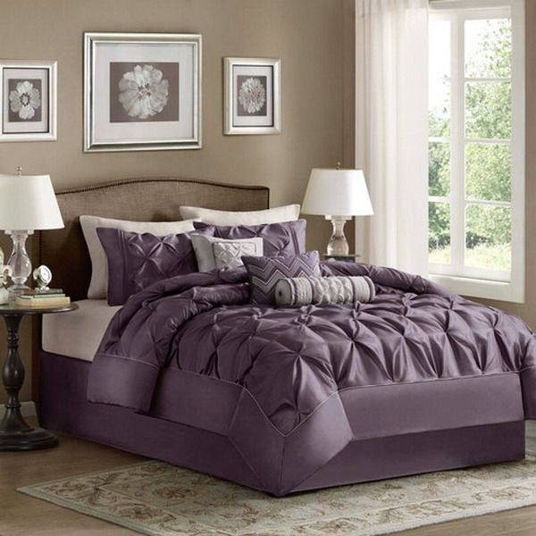 Our current carpet is a soft grey - this picture demonstrates that this colour will continue to work after we've introduced purple. I also like the collection of cushions and the throw on the bed, although this is something I may need to persuade him on!