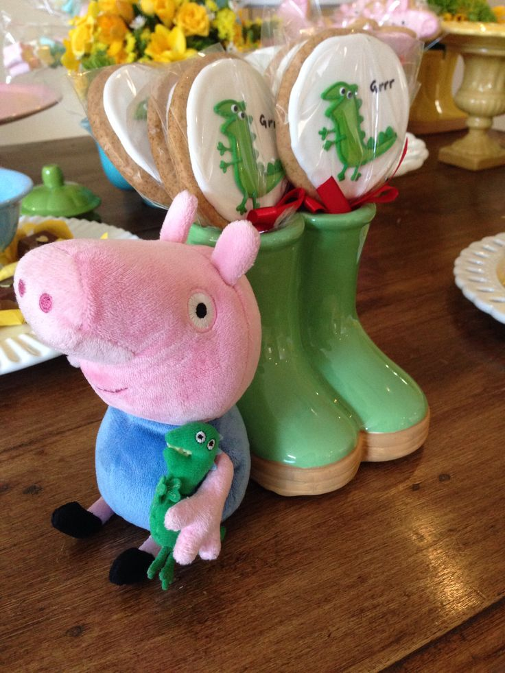 Peppa pig and George birthday party arrangement. I like how the dinosaur cookie pops are in the rain boots. Cute!