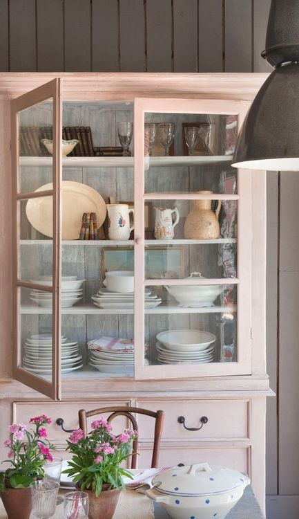 A glassed wall unit is perfect for storing and showing off crockery.