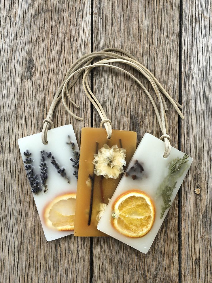 Each sachet is strung with a suede cord and enclosed in a charmingly  packaged box.  Set of two.  Perfect to hang in your closet, place in a drawer, or take in your  suitcase.   Available in various scents:  Lavender Tangerine  Honey Tobacco  Clementine Clove  Spicy Apple  Anjou Pe