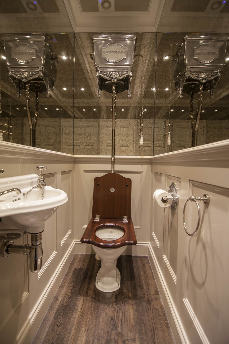 Chadder Blenheim High Level Toilet with a bespoke plaque stating the House Name. Chadder Mahogany throne toilet seat. A Chadder small cloakroom basin with solid brass taps in Nickel plate finish