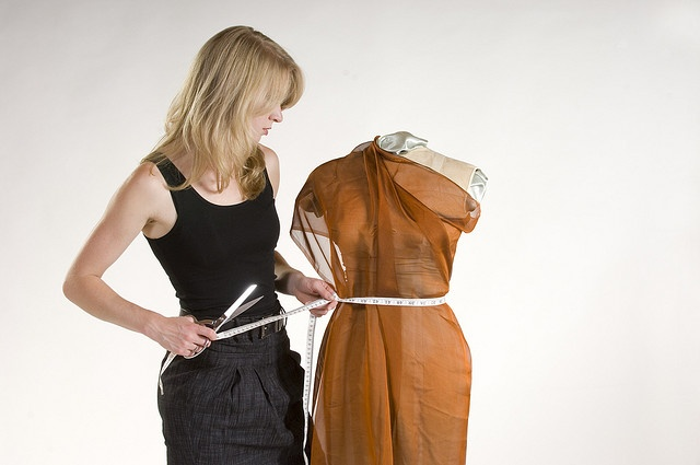 Fashion designer in black tank top and skirt works on a project with vintage mannequin     Some of the cool fashion images I found.   If  You are interested in  fashion designers here is something interesting http://fashiondesigncourse.easy2u.eu