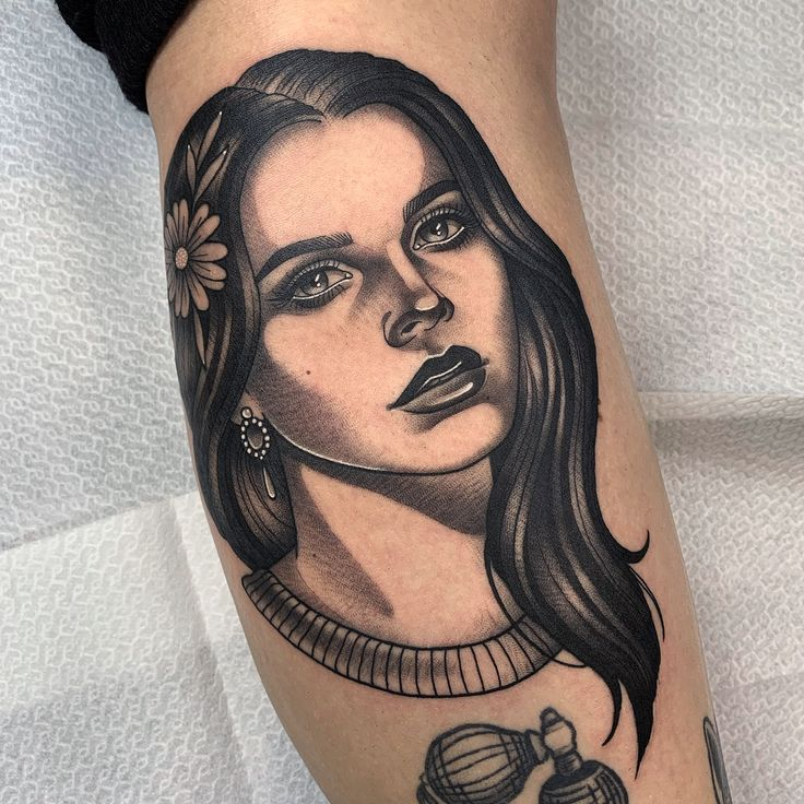 Black and grey neotraditional portrait tattoo of Lana del
