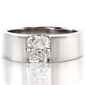 Simple, modern diamond solitaire engagement ring. A wide flat band holds a radiant cut center stone in a half bezel setting. Solstice from Knox Jewelers