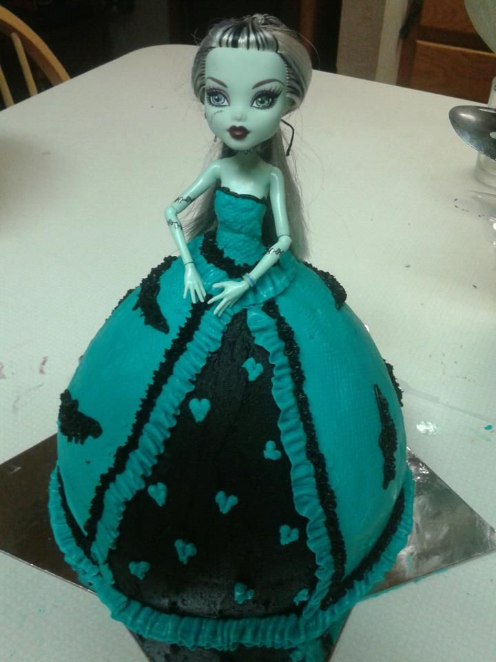 Monster High cake. Not looking forward to cooking another cake in the doll pan but a girl wants what a girl wants...
