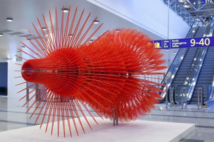 "A new art exhibition, with works by Hans-Christian Berg and Visa Norros, has opened at Helsinki Airport.    The most striking piece in the new collection is ""Light Space Linear Momentum"" by Berg.    Its shape is based on the rhythms of an EKG, illustrating the moment when the heart stops beating."