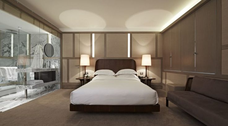Bedroom:Lovely Bedroom Interior Design Ideas With Fancy Wooden Platform Beds With White Cover Beds Also Pillows And Table Lamps Plus Brown Seating Set Also Large Mirror And Dark Floor Ideas The Amazing Modern Bedroom Interior Design Ideas For Your New Apartment