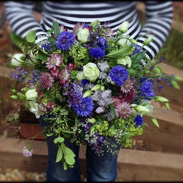 cornflowers brighten up a wedding bouquet