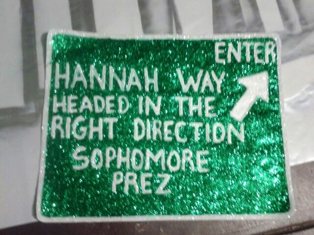 "High school campaigning theme"" headed in the right direction"" street signs made out of poster board hand painted with glitter to make them pop"