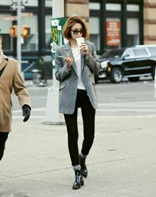 grey blazer, white tee, dark bottoms, grey socks, black boots