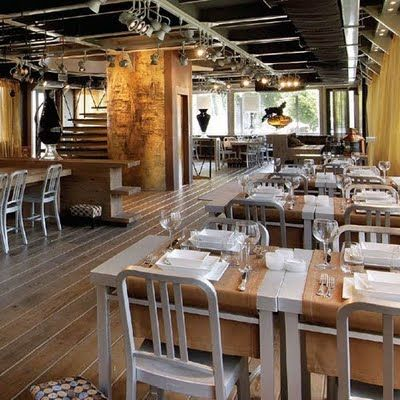 industrial design style restaurant using vintage emeco old navy chairs