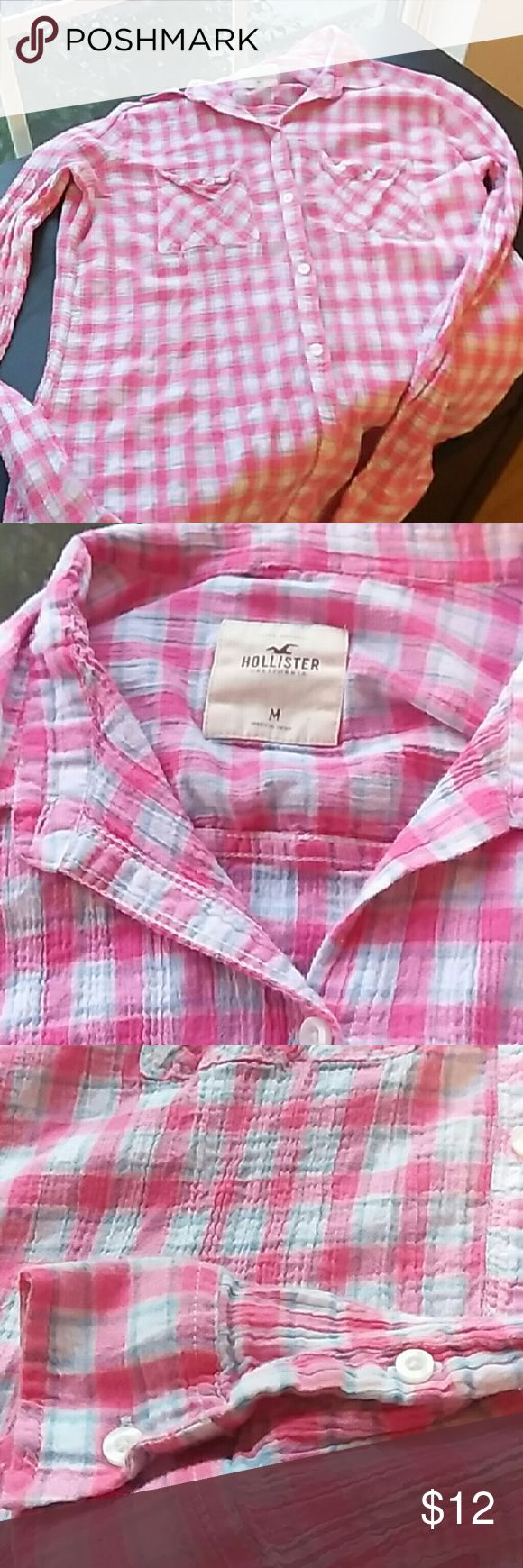 Woman's Medium Hollister Long Sleeve Pink,  light blue and white long sleeve button down shirt in excellent condition with no stains or tears and comes from a smoke and pet free home. Soft and comfy material. Don't agree with the price? Make offer! Hollister Tops Button Down Shirts